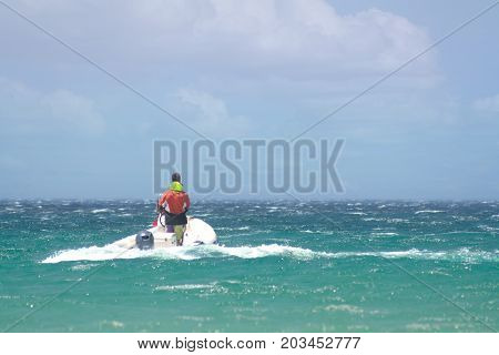 a man rides on a water scooter