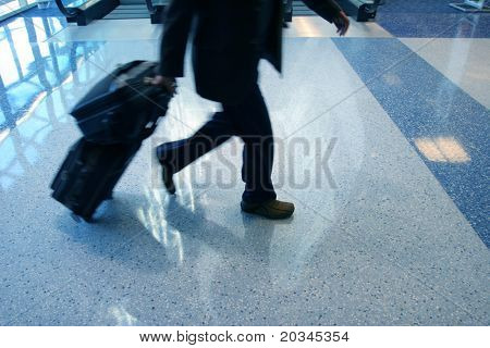 Man rushing to catch his flight in airport
