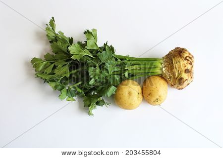 Celeriac root and two potatoes, horizontal aspect