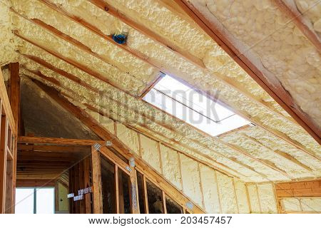 thermal and hidro insulation Inside wall insulation in wooden house building under construction