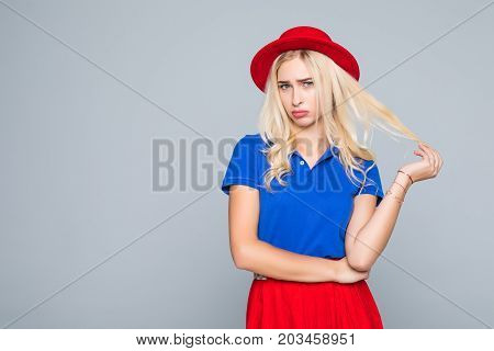 Portrait Of A Stunning Fashionable Lady Offended Girl In Bright Red Dress Posing Over Gray Backgroun
