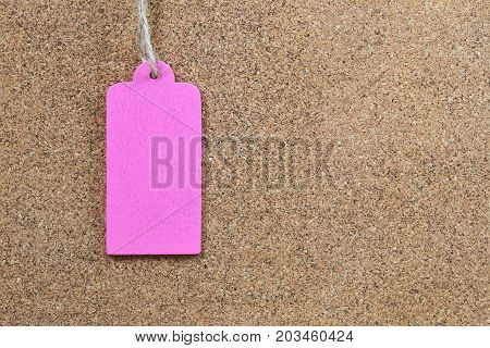 Pink empty wood sign on wooden cork background for input text in your want and have copy space.
