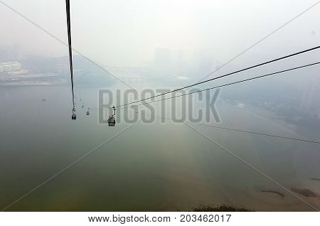 In to the mist. the long travel via cable and cabin into the mist to the mountain high.