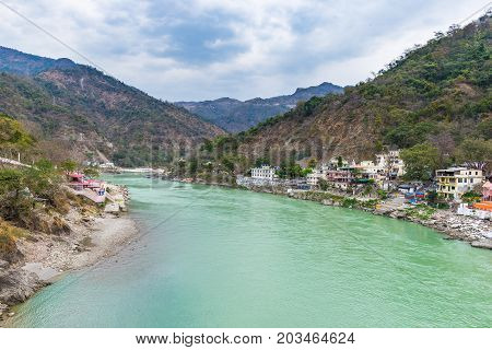 Dramatic Sky At Rishikesh, Holy Town And Travel Destination In India. Colorful Sky And Clouds Reflec