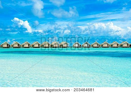 Wooden villas over water of the Indian Ocean Maldives