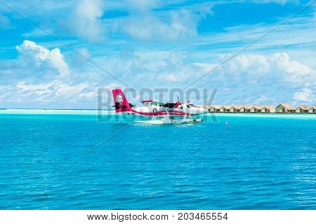 South Atoll Dhidhoofinolhu Maldives - July 08 2017: Hydroplane in the crystal clear turquoise water of the Indian Ocean near tropical islands Maldives