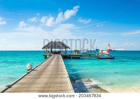 South Atoll Dhidhoofinolhu Maldives - July 04 2017: hydroplane near the wooden pier in Dhidhoofinolhu island Maldives