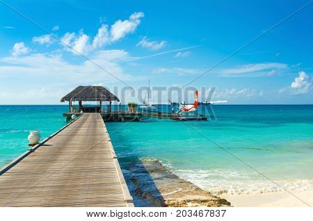 South Atoll Dhidhoofinolhu Maldives - 04  July 2017: hydroplane near the wooden pier in Dhidhoofinolhu island Maldives