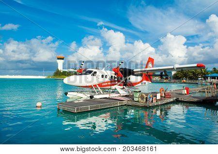 MALE MALDIVES - JULY 04 2017: hydroplane near the wooden pier