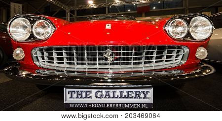 MAASTRICHT NETHERLANDS - JANUARY 09 2015: Sports car Ferrari 330GT 2+2 «Interim» 1965. Close-up. International Exhibition InterClassics & Topmobiel 2015