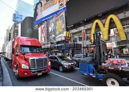 NEW YORK CITY USA - AUG. 24 : Traffic on street in Manhattan on August 24 2017 in New York City NY. Manhattan is the most densely populated borough of New York City.