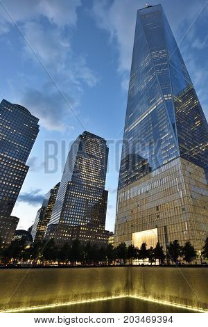 NEW YORK CITY - AUGUST 24: 9/11 Memorial at World Trade Center Ground Zero on August 24 2017 in New York City USA.