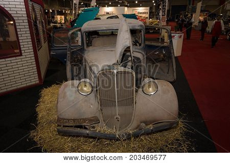 MAASTRICHT NETHERLANDS - JANUARY 09 2015: Rusty body of a compact car Renault Monaquatre 1934. International Exhibition InterClassics & Topmobiel 2015