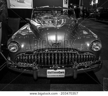 MAASTRICHT NETHERLANDS - JANUARY 09 2015: Full-size car Buick Super convertible (Third generation) 1949. Black and white. International Exhibition InterClassics & Topmobiel 2015