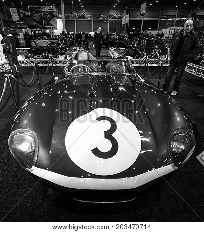 MAASTRICHT NETHERLANDS - JANUARY 09 2015: Sports racing car Jaguar D-Type (number of chassis: XKD606 winner of the 1957 Le Mans 24 Hours race) 1956. Black and white. International Exhibition InterClassics & Topmobiel 2015