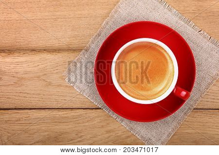 Full Cup Of Espresso Coffee In Red Cup On Table
