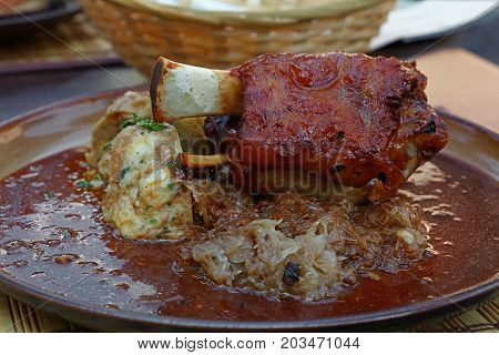 Portion Of Roasted Pork Shank With Dumplings
