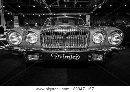 MAASTRICHT NETHERLANDS - JANUARY 09 2015: Luxury car Daimler Sovereign Double-Six Serie 2 LWB 1973. Black and white. International Exhibition InterClassics & Topmobiel 2015