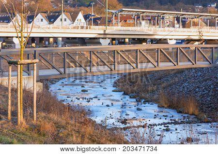 Bridge over the frozen river Ruhr in winter