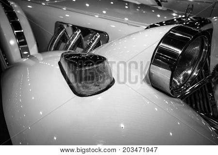 MAASTRICHT NETHERLANDS - JANUARY 09 2015: Fragment of a wedding limousine neo-classic car Cmc Tiffany built based on modern cars Ford. Black and white. International Exhibition InterClassics & Topmobiel 2015