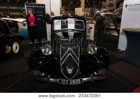 MAASTRICHT NETHERLANDS - JANUARY 09 2015: French mid-size luxury car Citroen Traction Avant 1952. International Exhibition InterClassics & Topmobiel 2015