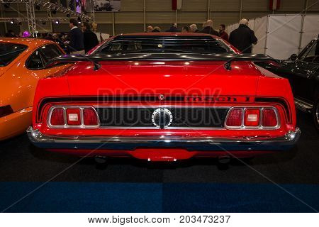 MAASTRICHT NETHERLANDS - JANUARY 09 2015: The muscle car Ford Mustang Mach 1 1973. Rear view. International Exhibition InterClassics & Topmobiel 2015