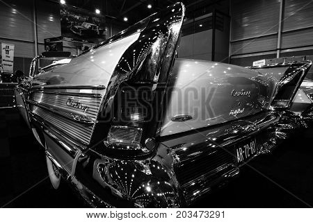 MAASTRICHT NETHERLANDS - JANUARY 09 2015: Fragment of a full-size car Buick Century Riviera convertible 1958. Rear view. Black and white. International Exhibition InterClassics & Topmobiel 2015