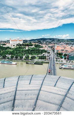 Bratislava is the capital city of Slovak republic. Beautiful castle Saint Martin's cathedral bridge SNP Danube river and Kamzik TV Tower. Architectural theme. Blue photo filter.