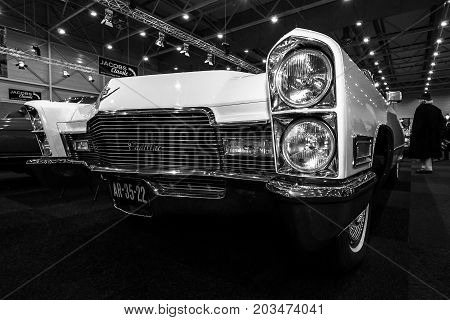 MAASTRICHT NETHERLANDS - JANUARY 09 2015: Detail of a full-size luxury car Cadillac Sixty Special (Ninth generation). Black and white. International Exhibition InterClassics & Topmobiel 2015