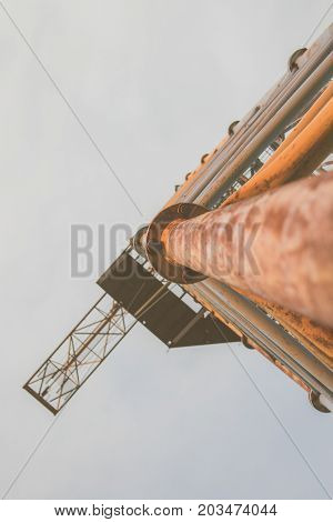 Old Rusty Abandoned Building Gantry Crane On Rusty Rails.