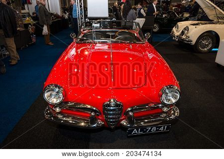MAASTRICHT NETHERLANDS - JANUARY 09 2015: Compact car Alfa Romeo Giulietta Spider bodywork by Pininfarina. International Exhibition InterClassics & Topmobiel 2015