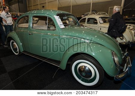 MAASTRICHT NETHERLANDS - JANUARY 09 2015: Oldtimer Volkswagen Beetle 1966. International Exhibition InterClassics & Topmobiel 2015