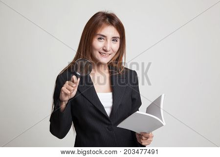 Asian Woman With A Book And Magnifying Glass.