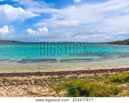 The beautiful turquoise waters around the island of Guadeloupe on a cloudy summer day, French Antilles, Caribbean.