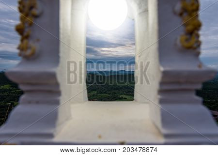 A nature view with a circle white light shoot through white cement lamp at Temple, One of the most important places in the district of Li it is also a viewpoint of the city where you can see the sunrise in the morning mist.
