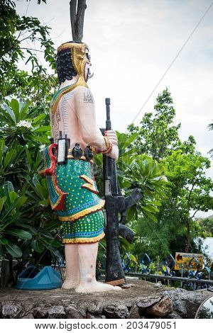 Giant statues serve as watchmen. In handheld weapons are guns and bombs protecting the temple.