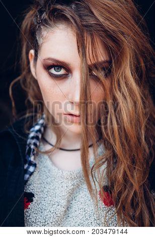 Close-up portrait of the sad beautiful grunge (rock) girl