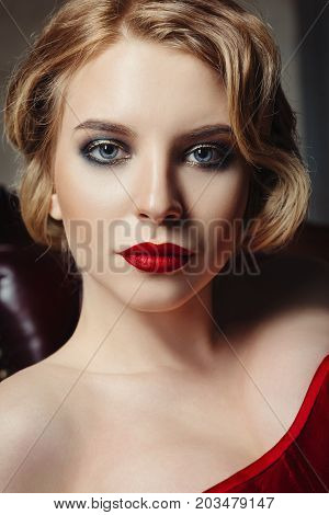 Close-up portrait of the gorgeous young woman. Retro (vintage) style