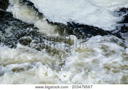seething and foamy waters of the mountain river