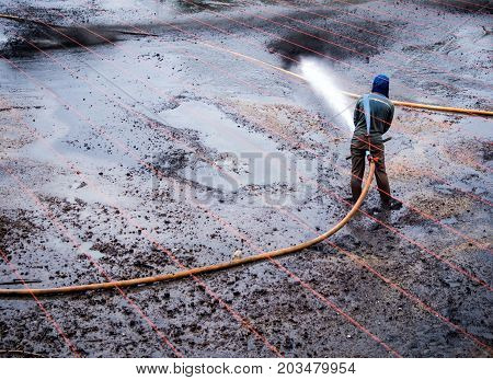 Cleaning The Mud At The Bottom Of Pond