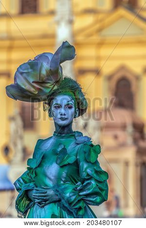 TIMISOARA ROMANIA - SEPTEMBER 8 2017: Living statue of a woman dressed with summer elements and present on the street inside the CheckART Carnival organized by the City Hall Timisoara. Union Square.