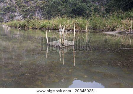 fish trap in a small river Vietnam
