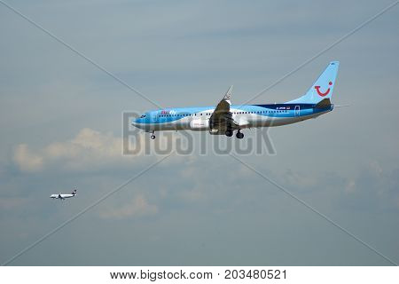 FRANKFURT, GERMANY - JUL 09th, 2017: TUIfly AIRLINES Boeing 737-800 lands at Frankfurt airport with other plane in the background, Boeing 737 Next Gen, MSN 41660, Registration D-ATUN, TUIfly-a German leisure airline owned by the travel and tourism company