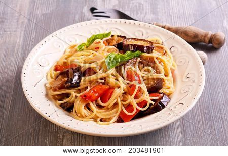 Vegetable (aubergine courgette pepper) pasta on plate