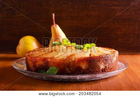 Gingerbread pear upside down cake on plate