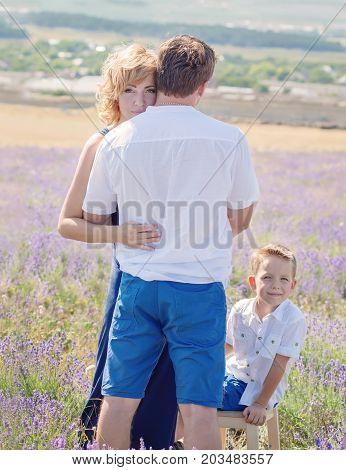 Happy young family outdoors in a lavender field