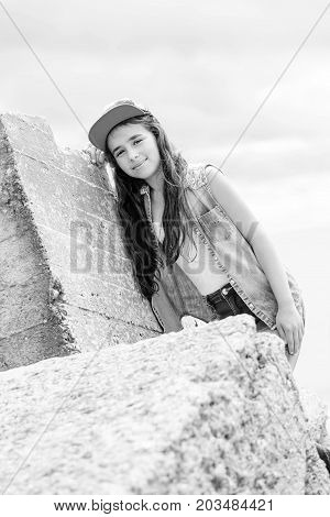 portrait of a young girl in denim on sky background ( black and white )