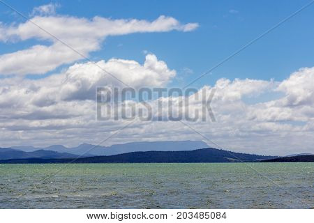 Isthmus bay Bruny Island Tasmania with Mount Wellington and sleeping beauty in background