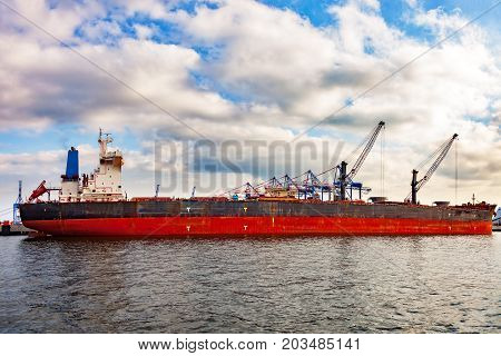 Cargo ship moored at the quayside in the port of Gdansk Poland.