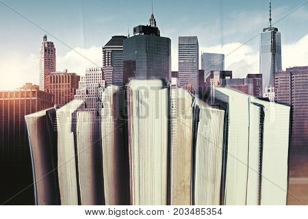 Abstract book on creative city background. Literature concept. Double exposure